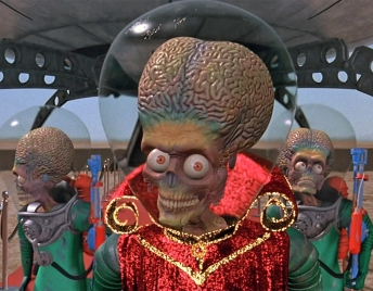 "©WARNER BROS. PICTURES The Martian ambassador disembarks from his spaceship in ""Mars Attacks!"" the 1996 Tim Burton sci-fi comedy that will be shown after dark Friday on the grounds of the Kansas Museum of History as part of its Sundown Film Festival."