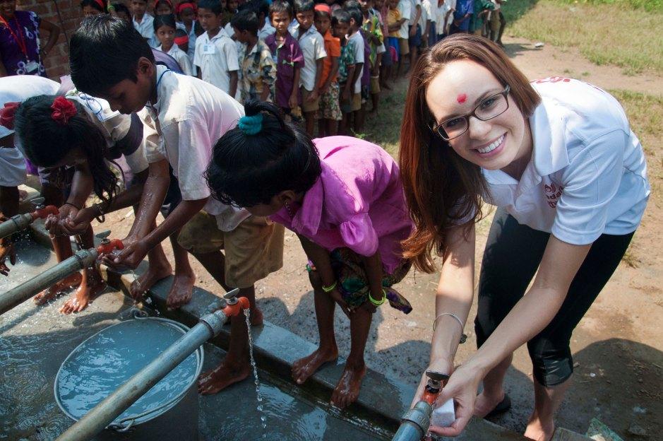 Erin-washing-hands-in-Shilonda.jpg